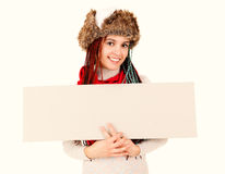 Winter girl with blank poster Stock Photography