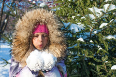 Winter girl blow on snow Stock Images