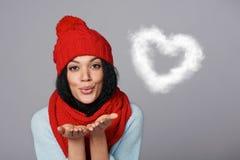 Winter girl blowing cloud heart shape Stock Photography