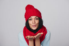 Winter girl blowing a kiss Royalty Free Stock Photos
