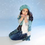 Winter girl Blowing Snow Royalty Free Stock Images