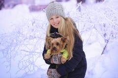 Winter girl blowing snow. Beauty Joyful Teenage Model Girl having fun in winter park. Beautiful girl laughing outdoors. Enjoying n Stock Photography