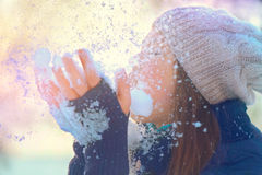 Winter girl blowing snow in frosty winter park. Beauty winter girl blowing snow in frosty winter park Stock Image