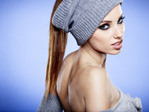 Winter girl on the blue  background. Beauty winter girl on the blue  background Stock Image