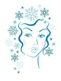 Winter girl with blue snowflakes hair Royalty Free Stock Photo