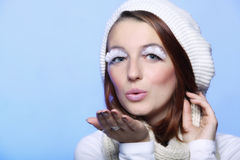 Winter girl with creative makeup blowing kiss Royalty Free Stock Images