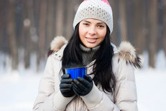 Winter girl with cup Royalty Free Stock Photography