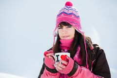 Winter girl with the cup of tea Stock Photography