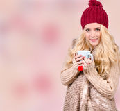 Winter girl drinking tea Stock Photos