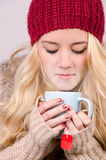 Winter girl drinking tea Royalty Free Stock Photo