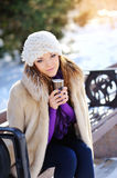 Winter girl drinking warm beverage Royalty Free Stock Images