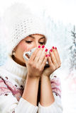 Winter girl drinking warm beverage Stock Photo