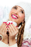 Winter girl drinking warm beverage Stock Image
