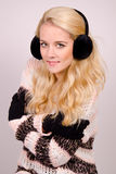 Winter girl with earmuffs Stock Photos
