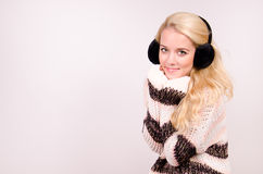Winter girl with earmuffs Royalty Free Stock Photos