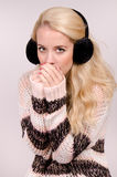 Winter girl with earmuffs Stock Images