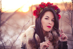 Winter girl with flowers. Young woman wearing flowers on her head lifestyle photo Royalty Free Stock Images