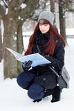 Winter girl with a folder for papers Royalty Free Stock Image