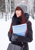 Winter girl with a folder for papers Royalty Free Stock Images