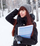 Winter girl with a folder for papers Stock Photography