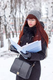 Winter girl with a folder for papers Stock Photo