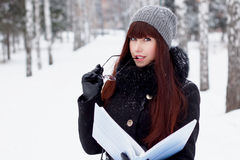 Winter girl with a folder for papers Stock Photos