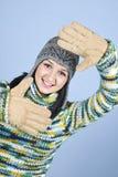 Winter girl framing face Stock Photos