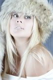 Winter girl in fur hat Royalty Free Stock Photography