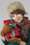 Winter girl with gift Stock Photography