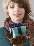 Winter girl with gift Stock Photos