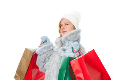 Winter girl with gift bags. In the background Stock Images