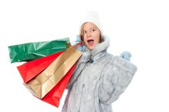 Winter girl with gift bags Stock Photo