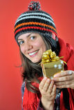 Winter girl with gift Royalty Free Stock Photography