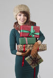 Winter girl with gifts Stock Photography