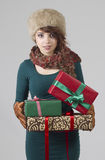Winter girl with gifts Royalty Free Stock Photography