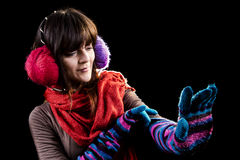 Winter girl with glove Royalty Free Stock Photo