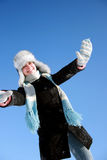 Winter girl with hands up Stock Photos