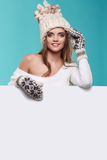 Winter girl happy smile hold sale poster, attractive young excit Royalty Free Stock Photos