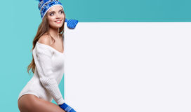 Winter girl happy smile hold sale poster, attractive young excit Stock Photo