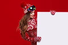 Winter girl happy smile hold sale poster, attractive young excit Royalty Free Stock Image