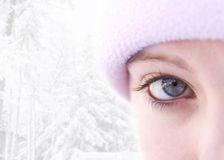 Winter girl high-key. Close-up of a blue eyed female outside in winter(focus on eye royalty free stock photography