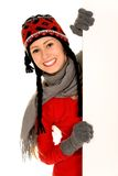 Winter girl holding blank sign Stock Image