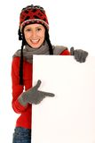 Winter girl holding blank sign Royalty Free Stock Image