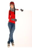 Winter girl holding blank sign Royalty Free Stock Photo