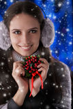 Winter Girl Holding a Christmas Decoration Royalty Free Stock Image