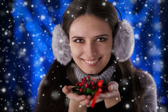 Winter Girl Holding a Christmas Decoration Stock Photos