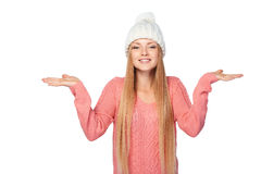 Winter girl holding copy space on her palms Royalty Free Stock Image
