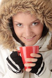 Winter girl with hot cup Royalty Free Stock Photography