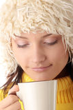 Winter girl with hot cup Royalty Free Stock Image