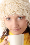 Winter girl with hot cup Royalty Free Stock Photos